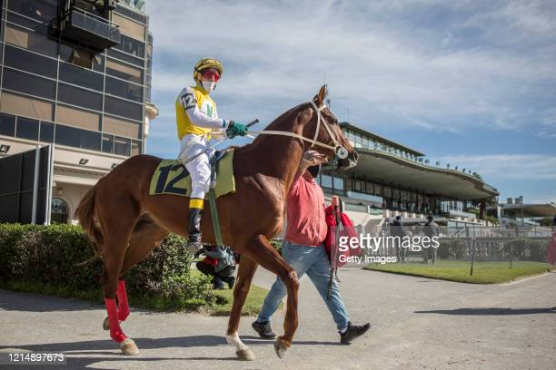 Jockey Pablo Menyou prepares to enter the race track during competition day as Uruguay slowly returns to normal due to coronavirus outbreak at...
