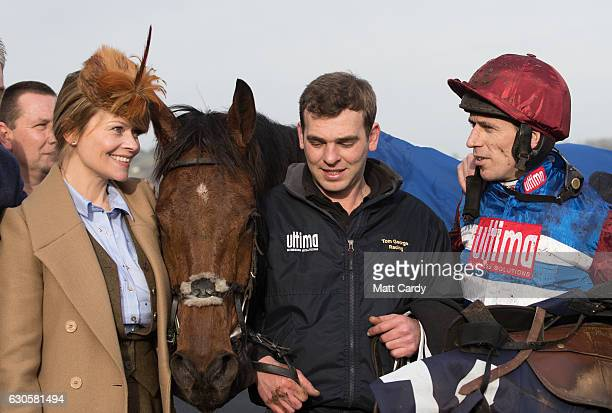 Jockey Paddy Brennan stands with the winning horse he rode The Worlds End in the parade ring following the first race during the 2016 Coral Welsh...