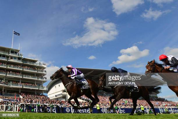 Jockey Padraig Benny races on Wings of Eagles to win the Epsom Derby on the second day of the Epsom Derby Festival in Surrey southern England on June...