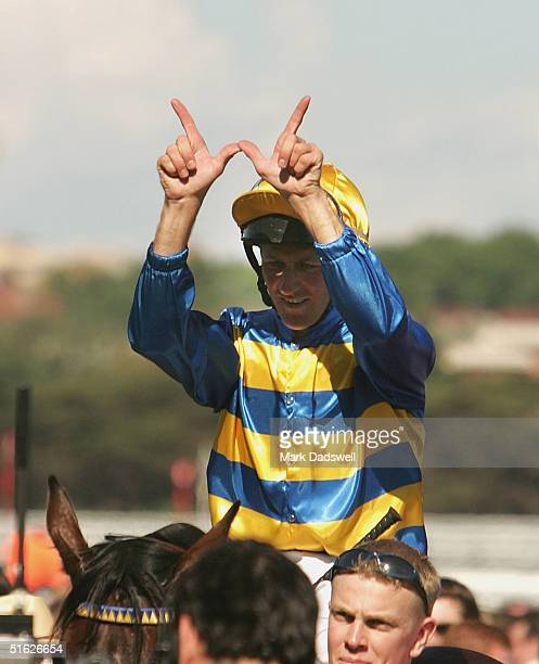 Jockey Paul Harvey celebrates as he returns to scale after winning the AAMI Victoria Derby on Plastered during the AAMI Victoria Derby Day at...