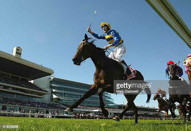 Jockey Paul Harvey celebrates as he wins the AAMI Victoria Derby on Plastered during the AAMI Victoria Derby Day at Flemington Racecourse October 30...
