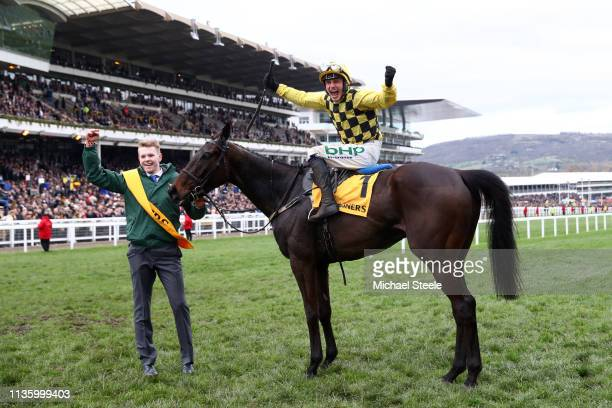 Jockey Paul Townend celebrates following his victory with horse Al Boum Photo in The Magners Cheltenham Gold Cup Steeple Chase during the Gold Cup...