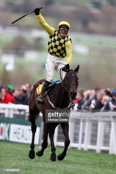 Jockey Paul Townend celebrates with horse Al Boum Photo following their victory in The Magners Cheltenham Gold Cup Steeple Chase during the Gold Cup...
