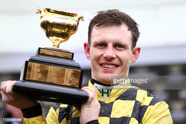 Jockey Paul Townend celebrates with the Gold Cup following his victory with horse Al Boum Photo in The Magners Cheltenham Gold Cup Steeple Chase...