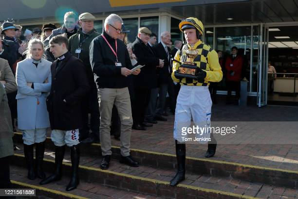 Jockey Paul Townend exits the weighing room carrying the Gold Cup before he defends his title on Al Boum Photo during day four of the Cheltenham...