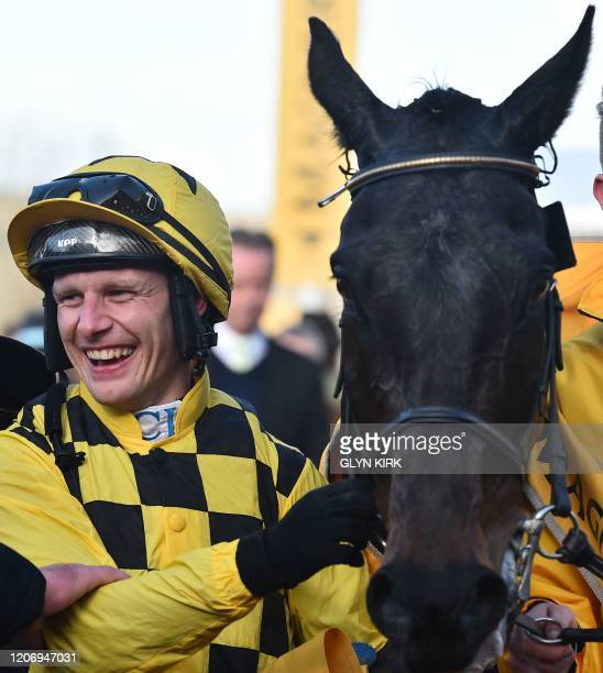 Jockey Paul Townend poses with his horse Al Boum Photo after winning the Gold Cup race on the final day of the Cheltenham Festival horse racing...