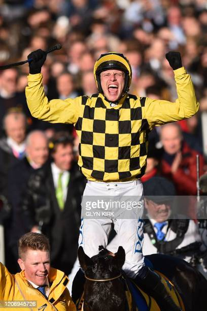Jockey Paul Townend rides Al Boum Photo as he celebrates after winning the Gold Cup race on the final day of the Cheltenham Festival horse racing...