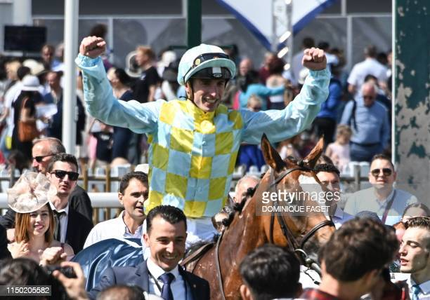 """Jockey Pierre-Charles Boudot on Channel reacts after winning the 170th """"Prix de Diane"""", a 2100-metre flat horse race, in Chantilly, north of Paris on..."""