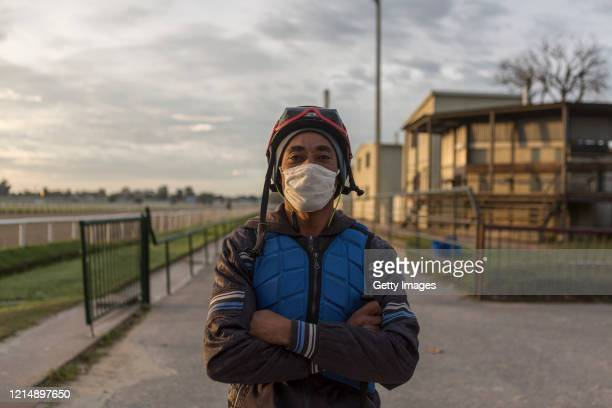 A jockey poses during horse training as part of competition day as Uruguay slowly returns to normal due to coronavirus outbreak at Maroñas Horse...