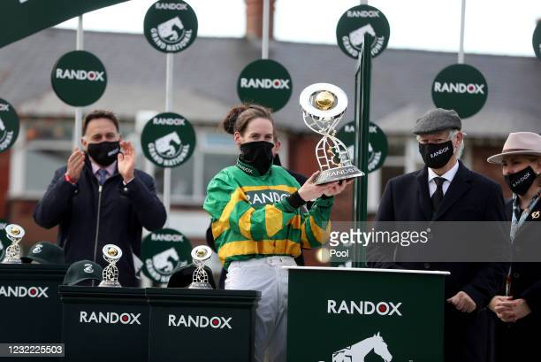 Jockey Rachael Blackmore receives the Randox Grand National Handicap Chase trophy after winning on Minella Times on Grand National Day of the 2021...