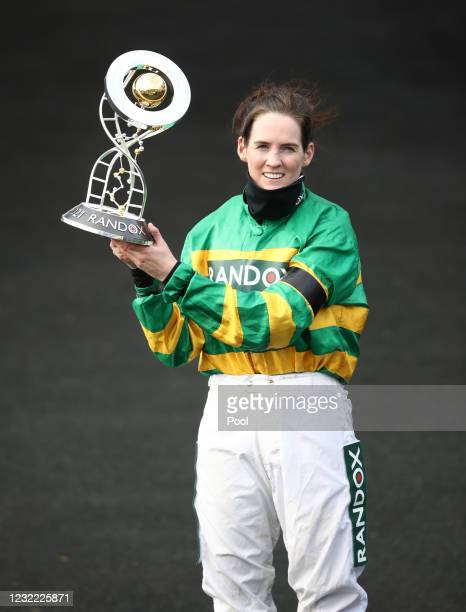 Jockey Rachael Blackmore receives the Randox Grand National Handicap Chase trophy after winning on Minella Times during Grand National Day of the...