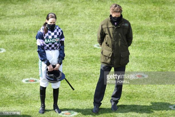 Jockey Rachael Blackmore stands for a two minute silence following the death of Britain's Prince Philip, Duke of Edinburgh yesterday on Grand...