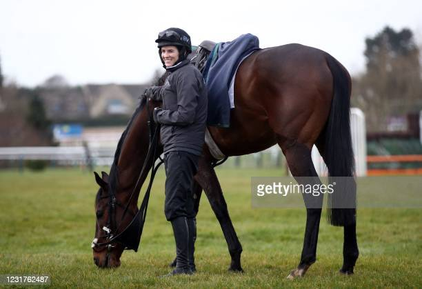 Jockey Rachael Blackmore stands with horse A Plus Tard on the gallops ahead of Day Two of the Cheltenham Festival at Cheltenham Racecourse, in...