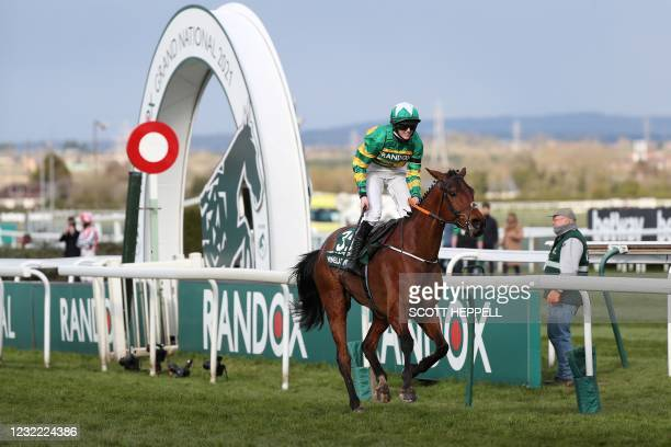 Jockey Racheal Blackmore rides 'Minelle times' wins the Grand National Hanidcap Chase on Grand National Day of the Grand National Festival at Aintree...