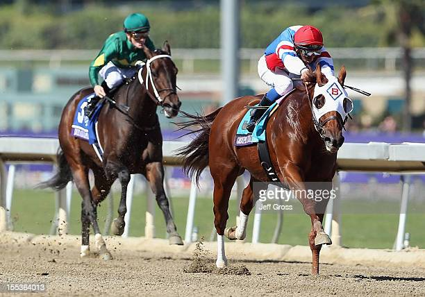 Jockey Rajiv Maragh atop Groupie Doll leads Julien Leparoux atop Dust and Diamonds down the stretch to win the Filly and Mare Sprint Race during the...