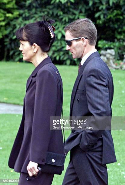 Jockey Ray Cochrane and his wife arrives at the funeral service of pilot Patrick Mackey held at St Joseph's Catholic Church in Newbury Berks Mr...