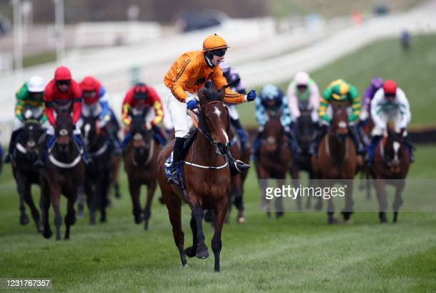 Jockey Richard Condon riding Heaven Help Us celebrates after winning the Coral Cup Handicap Hurdle at Cheltenham Racecourse on March 17, 2021 in...