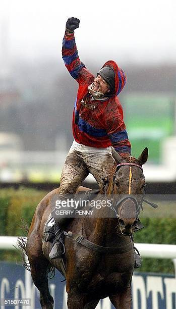 Jockey Richard Guest celebrates after winning with Red Marauder the 150th Grand National at Aintree 07 April 2001. Red Marauder won the Grand...