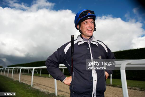 Jockey Richard Hughes looks on during a stable visit to Richard Hannon's Herridge yard ahead of 'Glorious Goodwood' on July 19 2011 in Malborough...