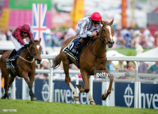 Jockey Richard Hughes rides Talent to victory in The Oaks at the Epsom Derby Festival in Surrey, southern England, on May 31, 2013. AFP PHOTO /...