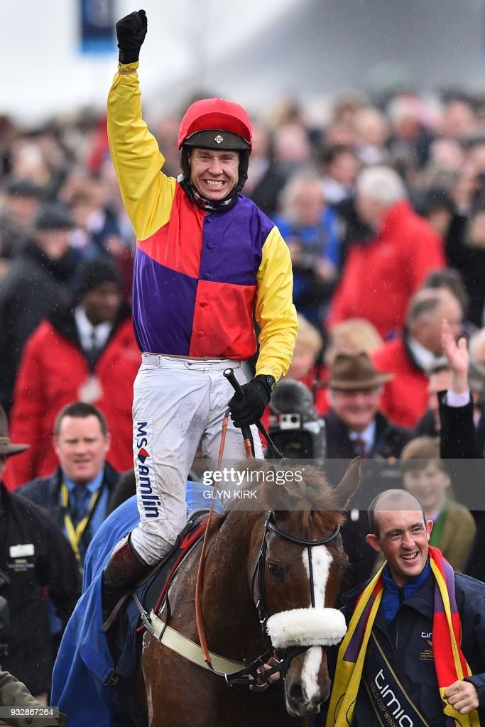 Jockey Richard Johnson celebrates with Native River after winning the Gold Cup race on the final day of the Cheltenham Festival horse racing meeting at Cheltenham Racecourse in Gloucestershire, south-west England, on March 16, 2018. PHOTO / Glyn KIRK