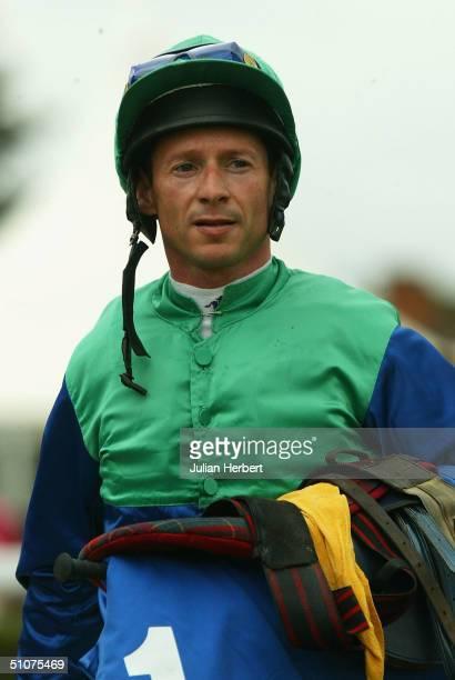 Jockey Richard Quinn looks on at Newbury Racecourse on July 16 2004 in Newbury England