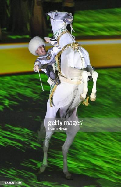 Jockey rides a white horse at an international event in Ashgabat on Nov. 1, 2018.