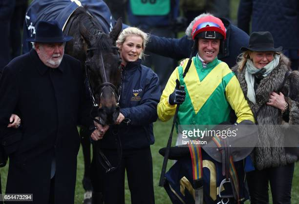 Jockey Robbie Power celebrates after steering Sizing John to victory in the Timico Cheltenham Gold Cup Chase during Gold Cup Day on day four of the...