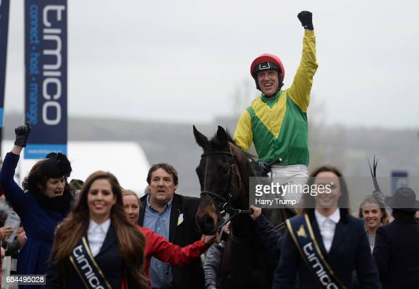 Jockey Robbie Power celebrates after winning the Gold Cup during Gold Cup Day of the Cheltenham Festival at Cheltenham Racecourse on March 17 2017 in...