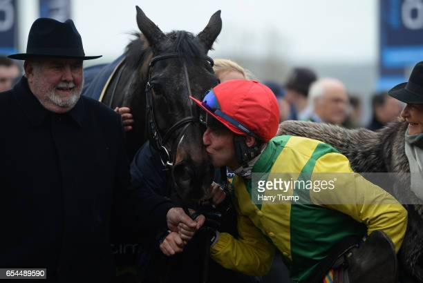Jockey Robbie Power kisses Sizing John after winning the Gold Cup during Gold Cup Day of the Cheltenham Festival at Cheltenham Racecourse on March 17...