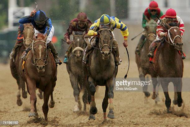 Jockey Robby Albarado riding Curlin passes Calvin Borel riding Street Sense to win the 132nd Preakness Stakes on May 19 2007 Pimlico Race Course in...