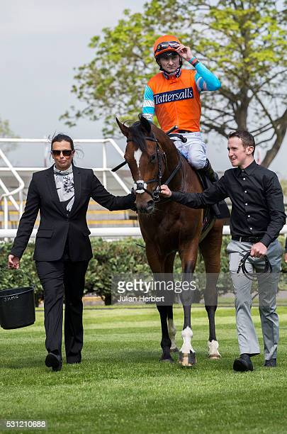 Jockey Robert Havlin and Cunco the first offspring of the champion racehorse Frankel to appear on a racecourse are lead back in by traveling head...