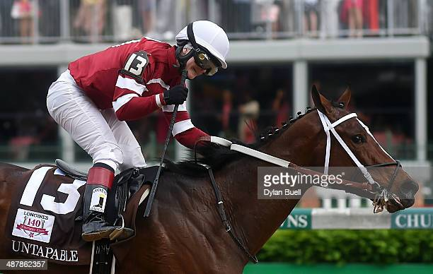 Jockey Rosie Napravnik celebrates atop of Untapable after crossing the finish line to win the 140th running of the Kentucky Oaks at Churchill Downs...