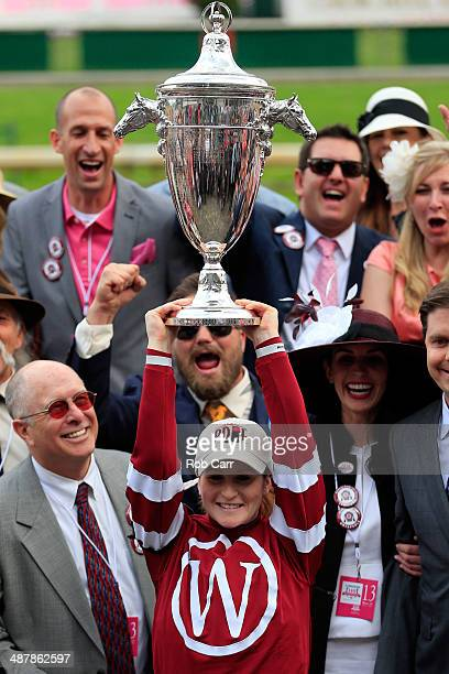 Jockey Rosie Napravnik celebrates with the trophy in the winners circle after guiding Untapable to win the 140th running of the Kentucky Oaks at...
