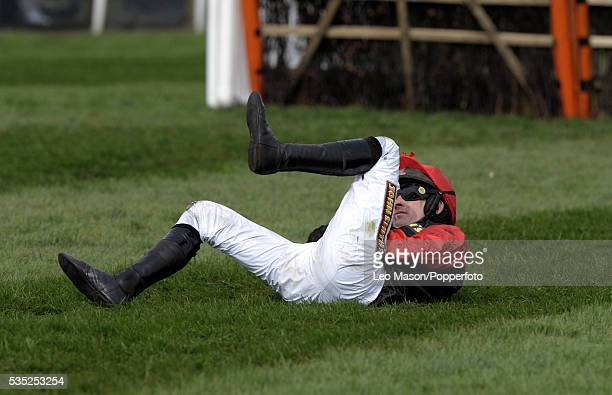 Jockey Ruby Walsh falls from his horse during competition in the John Smith's Dick Francis Aintree Hurdle race during the Grand National meeting at...