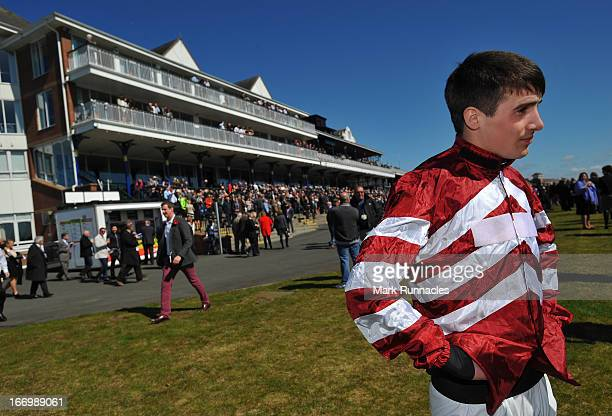 Jockey Ryan Mania competes during the Play Golf At Close House Handicap Hurdle Race, his first race meeting since his fall after winning the Grand...