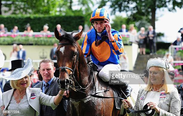 Jockey Ryan Moore celebrates after guiding Order of St George to victory in the Gold Cup in honour of the Queen's 90th Birthday during Day Three of...