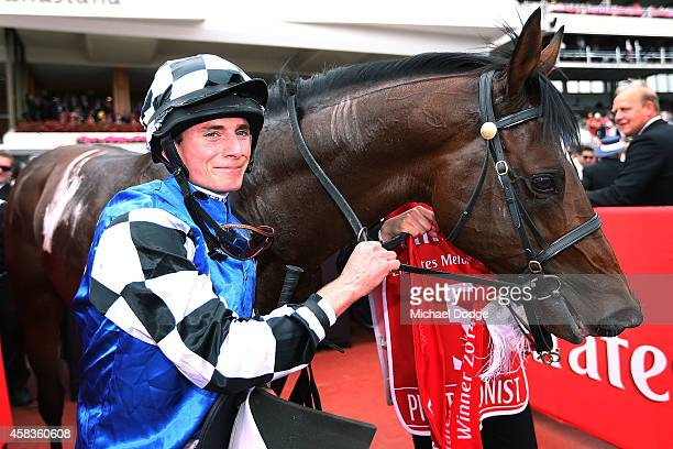 Jockey Ryan Moore celebrates after winning on Protectionist in race 7 the Emirates Melbourne Cup on Melbourne Cup Day at Flemington Racecourse on...
