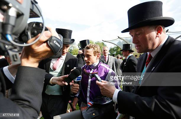 Jockey Ryan Moore celebrates after winning the Queen's Vase taking a record ninth victory at the royal meeting during Royal Ascot 2015 at Ascot...