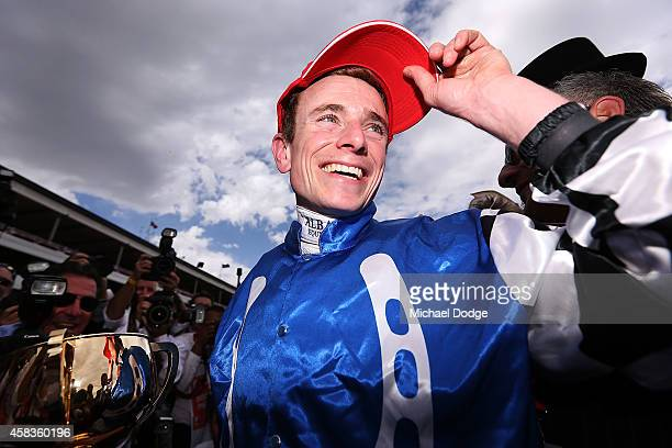 Jockey Ryan Moore celebrates with the trophy after winning on Protectionist in race 7 the Emirates Melbourne Cup on Melbourne Cup Day at Flemington...