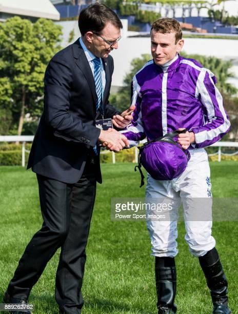 Jockey Ryan Moore celebrates with trainer Aidan Patrick O'Brien after winning the Longines Hong Kong Vase on Highland Reel during the Longines Hong...