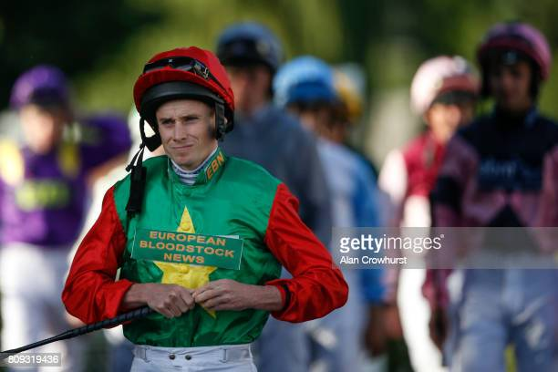 Jockey Ryan Moore makes his way to the parade ring before riding Billesdon Brook to victory for his 2000th British winner at Kempton Park racecourse...