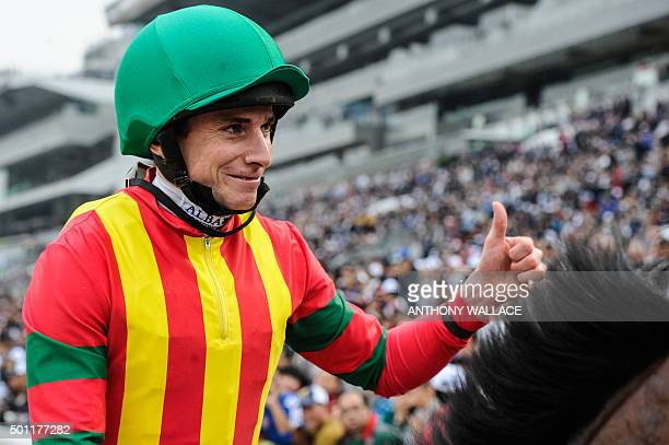 Jockey Ryan Moore of Britain riding Japanese horse Maurice trained by Noriyuki Hori of Japan gives a thumbs up to the crowd after winning the...