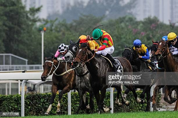 Jockey Ryan Moore of Britain uses his crop as he rides Japanese horse Maurice trained by Noriyuki Hori of Japan before winning the Longines Hong Kong...