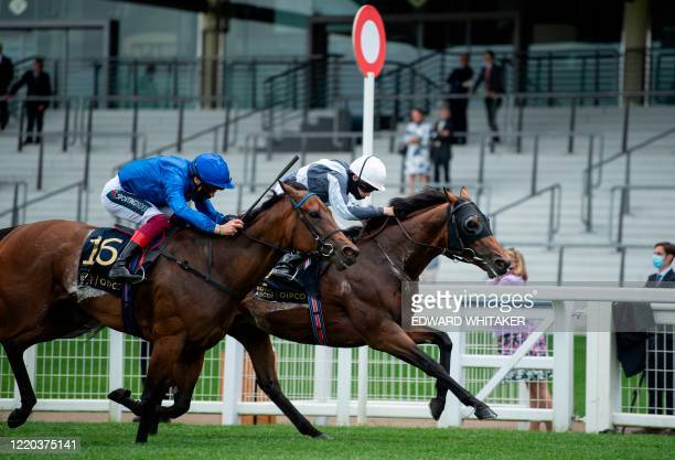 Jockey Ryan Moore on Circus Maximus beats Frankie Dettori on Terebellum in the Queen Anne Stakes race on day one of the Royal Ascot horse racing...