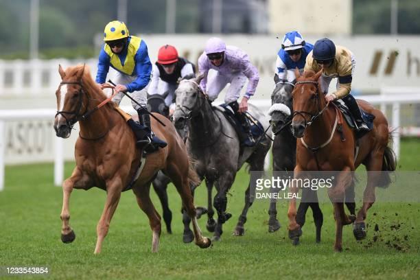 Jockey Ryan Moore rides Dream of Dreams ahead of second place jockey Hollie Doyle on Glen Shiel and third placed jockey Silvestre De Sousa on Art...