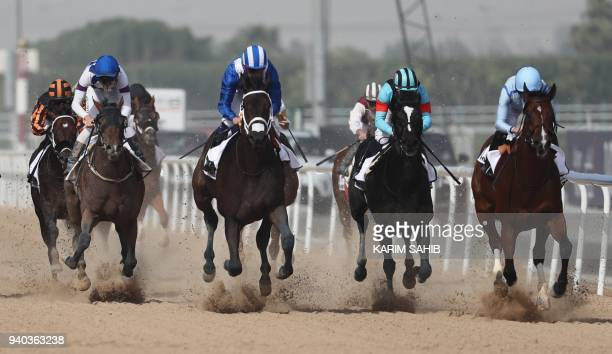 Jockey Ryan Moore rides Heavy Metal before winning the Godolphin Mile horse race at the Dubai World Cup in the Meydan Racecourse on March 31 2018 in...