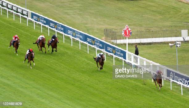 Jockey Ryan Moore rides Love to a nine length victory over stablemate Ennistymon, ridden by Seamie Heffernon in the Oaks Stakes at the Epsom Derby...