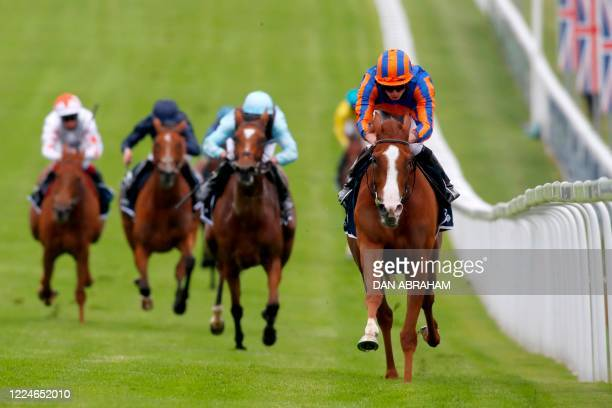 Jockey Ryan Moore rides Love to victory in the Oaks Stakes at the Epsom Derby Festival, south of London on July 4, 2020. - The Epsom Derby and Oaks...
