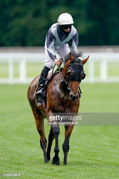 Jockey Ryan Moore riding Circus Maximus returns after winning The Queen Anne Stakes on day one of the Royal Ascot horse racing meet, in Ascot, west...